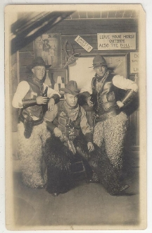 Cowboys with Guns, Leather Vest and Woolie Chaps Postcard