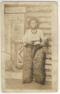 Cowboy with Two Guns Wearing Woolie Chaps Postcard