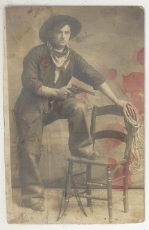 Cowboy With Revolver and Leather Chaps Postcard